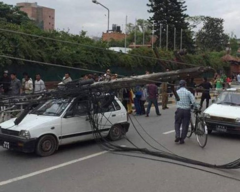 File:Electric poles uproot.jpg